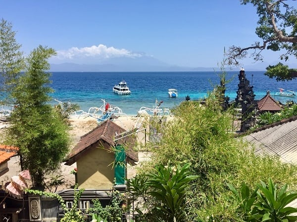 the gorgeous sea view with mount agung in the distance from the deva devi hotel in nusa penida in the hotel booking problem story