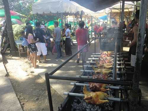 Living in the Philippines, you will see a lot of chickens roasted over coals on the street sides.