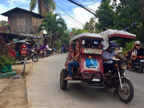 taxis in liloan are motorcycles with large side cars