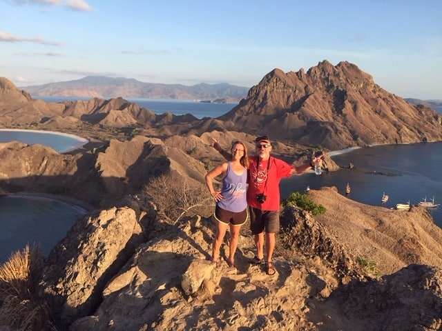 couple stands on top of Padar Island at sunrise on the cheap Komodo dragon tour