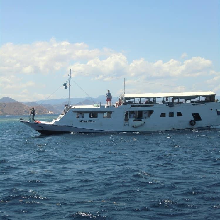 komodo dragon tour boat on flores sea