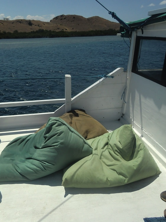 bean bag chairs on the deck of the a cheap komodo dragon tour boat