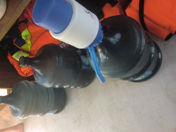 water jugs in the dining area of the cheap komodo dragon tour boat