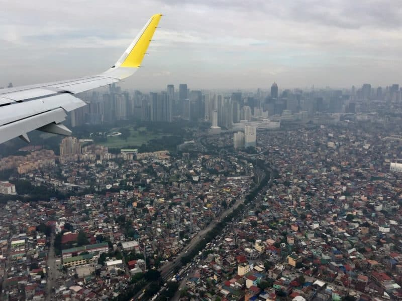 a plane flies over manila, philippines