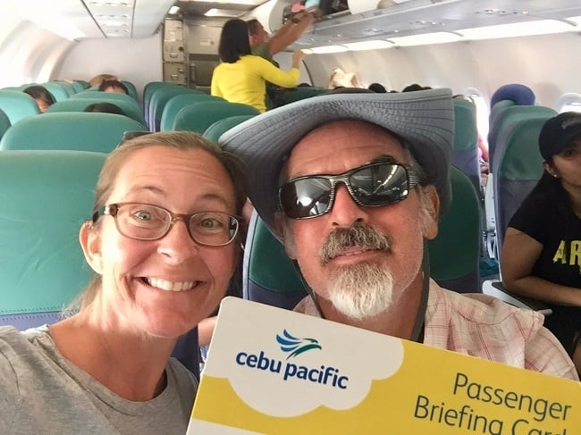 the author and his beautiful wife, happy on the plane after they showed proof of onward travel