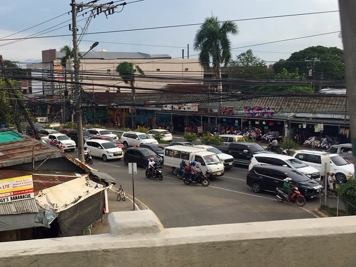 many newer vehicles sit in traffic in cebu city, named the most typical place in the world by a bloomberg columnist