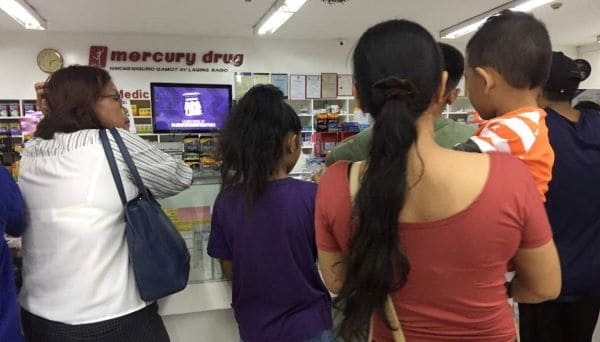 how to buy prescription drugs overseas - customers inside a pharmacy popular in the Philippines