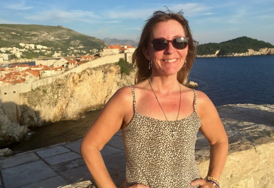 the author is pictured with Dubrovnik walls in the background after her lesson to be grateful