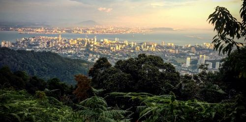 A overlook shows George Town on Penang Island, Malaysia - one of the best places to retire on social security overseas.