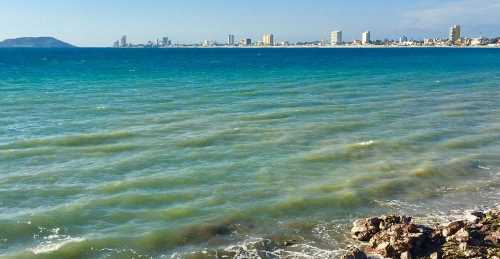 the bay and city skyline at mazatlan mexico -- on a calm day