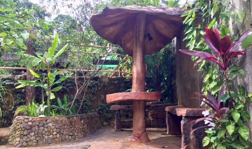 "A stone table and bench at the natural hot springs near Dumaguete called ""Red Rock Hot Springs Resort."