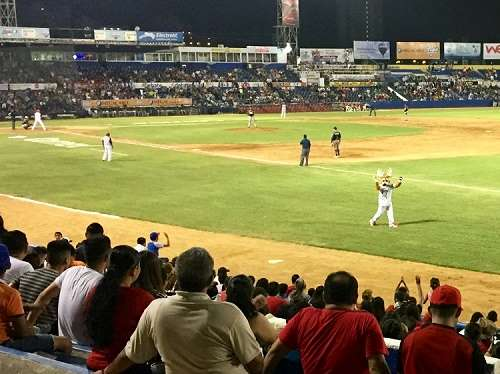 the venados de mazatlan, or the deer of mazatlan, mexico, play on the field during a home game with the deer mascot running around