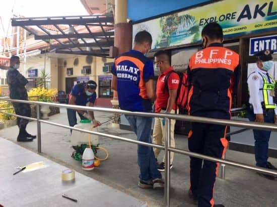 Security and cleaning crew outside the Caticlan port before Earth Vagabonds went on Philippine quarantine.