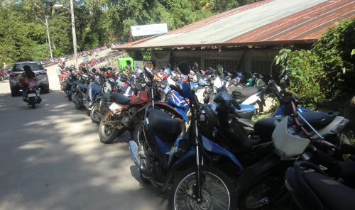 motorcycles parked outside cockfighting ring
