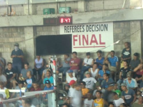 arena sign says 'referees (sic) decision final'