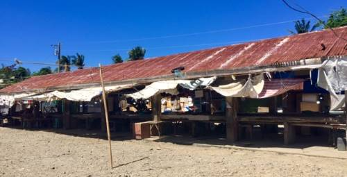 a broad look at the market in caticlan - with many vendors absent.