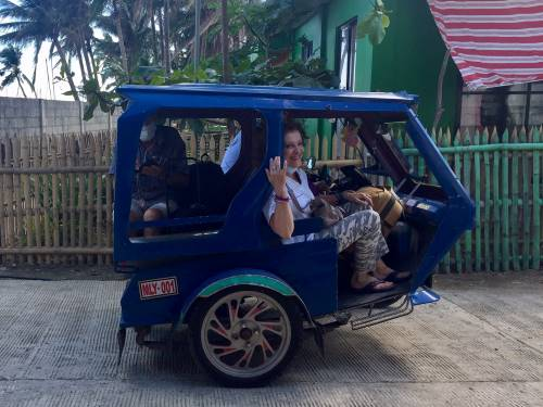 Philippine quarantine day 5 - Europeans leave the Hangout Beach Resort on a trike taxi.