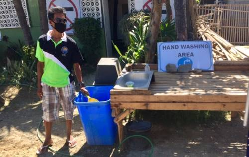 hand washing station at the market entrance on the supply run in the philippines during a pandemic