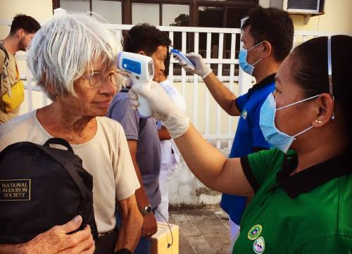 A temperature gun being used to test for coronavirus on Camiguin Island in the Philippines.