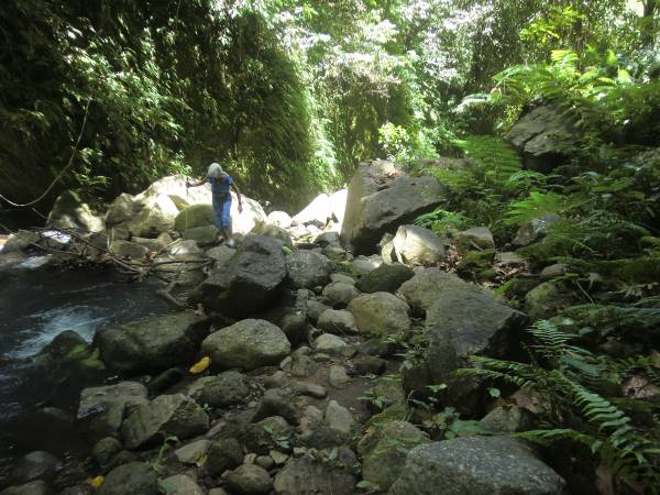 Tedly's mom, a grandmother of nine, navigates her way over boulders to The Original Casaroro Falls.