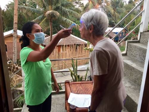 tedly's mom gets her temperature checked during philippine quarantine day 1