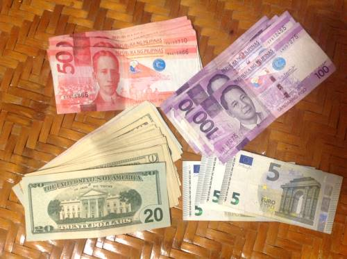 pesos, dollars, euros spread out on a table, on philippine quarantine day 7