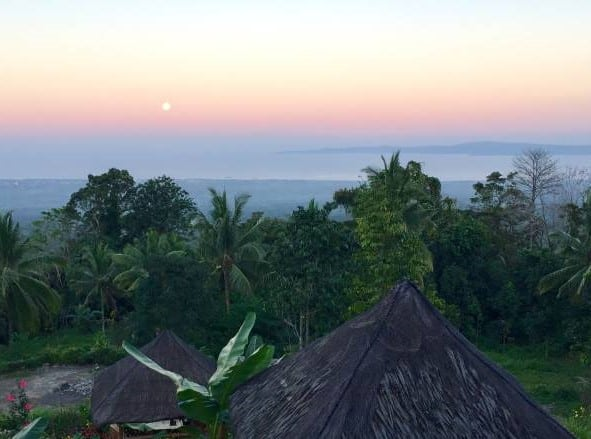 "The rising ""worm"" moon after sunset at Sheintan Ridge View Restaurant on Negros Oriental in the Philippines."