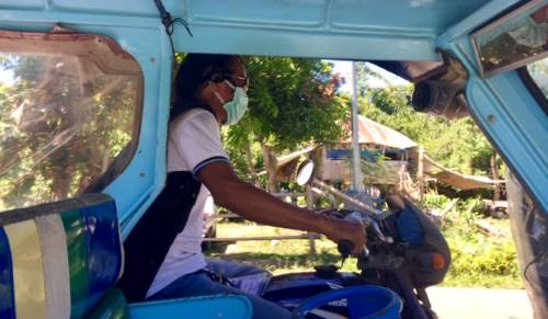 tricycle taxi driver wearing mask during Tedly's supply run