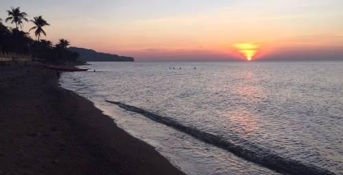 sunset near the hangout beach resort in malay, philippines