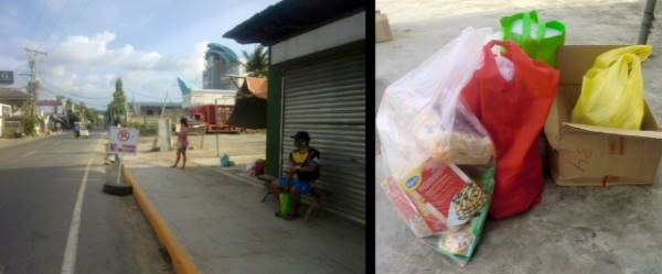 Travel trouble on supply run: empty street left, groceries in bags on ground on the right