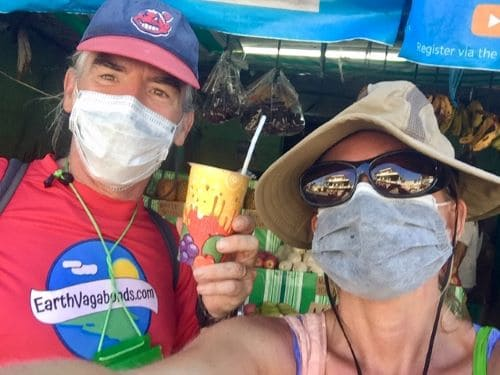 Bank stop, supply run to Caticlan - Tedly holds up a mango shake in a selfie with Ellen.