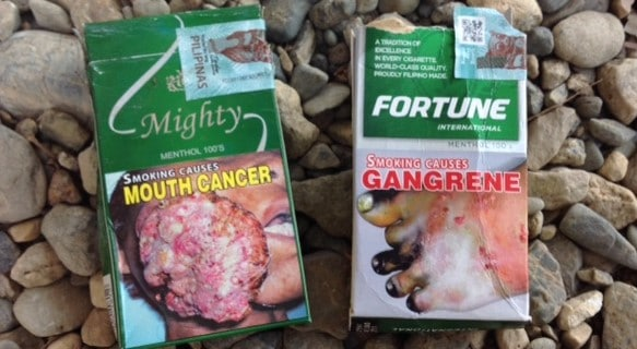 cigarette smoking in southeast asia comes withgraphic disease warnings on packs like these from the Philippines