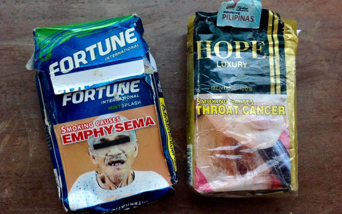 cigarette smoking in southeast asia, where packs have graphic images of disease