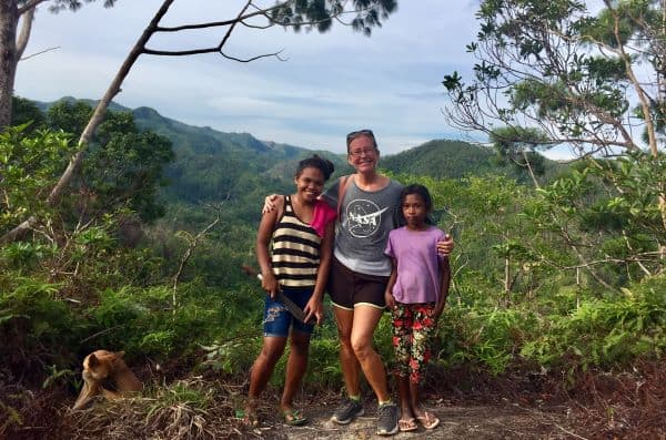 Two girls who are indigenous Ati people of Malay and Ellen on a mountain trail.