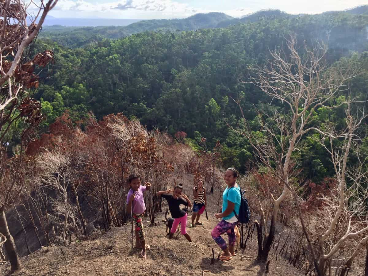 indigenous ati people on a steep mountainside