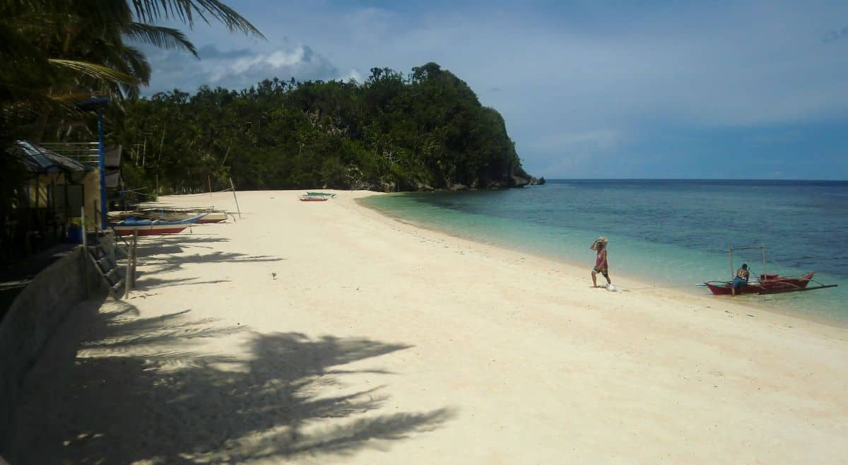 white beach at the perfect dive spot on panay island in the philippines