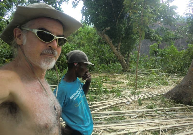 Tedly and Ati chief inspect work site on the mountain.