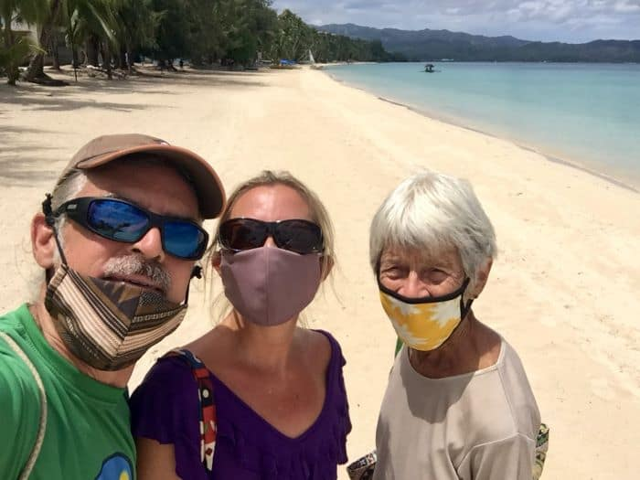 Tedly, Ellen, Tedly's mom Diane on White Beach in Boracay, in the blog entry for 'What we spend in July 2020.'