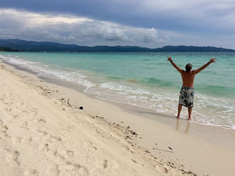 Tedly gives a victory pose on White Beach on Boracay Island.