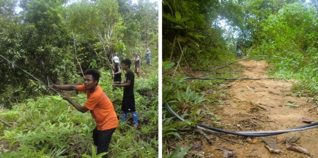 2 steps forward: Ati tribe members position the main electric line, given by the power company, to the upper village in Malay, Aklan, on Panay Island in the Philippines.