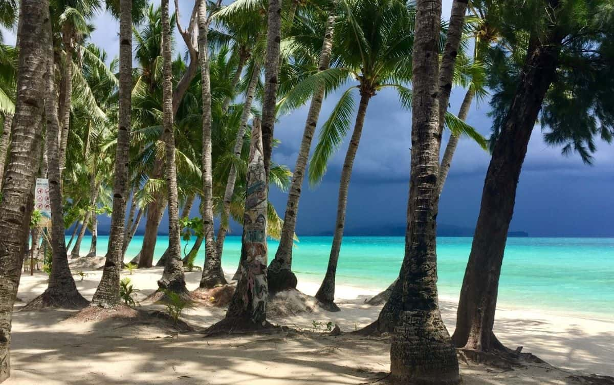 Dark gray storm clouds approach Boracay's White Beach.