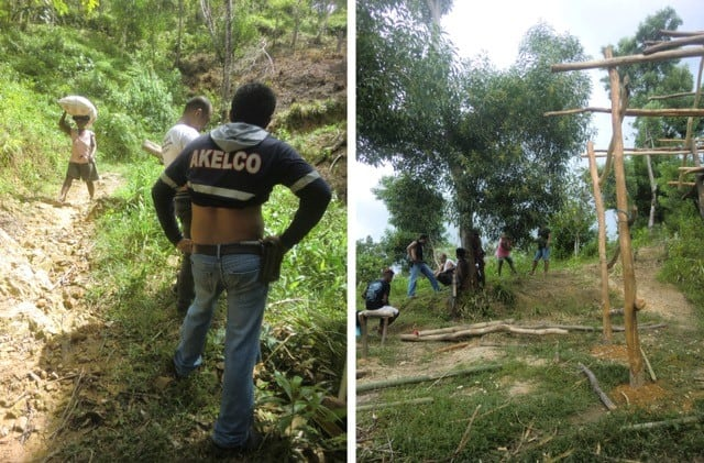 Akelco workers make a site visit on Ati mountainous land in Malay, Aklan, Philippines.