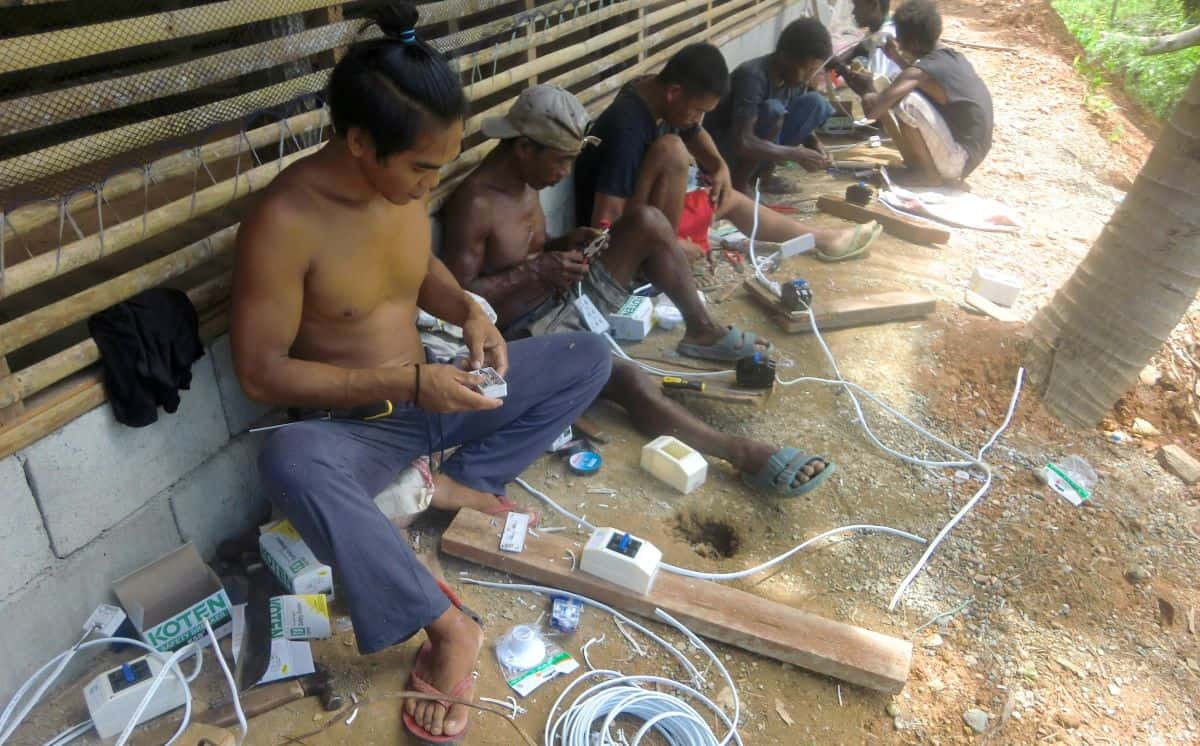 Ati work on sustainability projects- including wiring of native homes seen here- makes Tedly proud.
