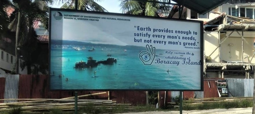 "A sign on Boracay Island helps along a pandemic lesson on enoughness. It reads, ""Earth provides enough to satisfy every man's needs, but not every man's greed."""