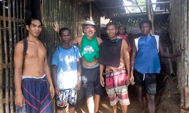 Tedly and several young men smile during a break from Ati work on sustainability projects.