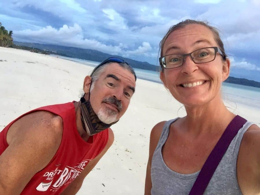 breast cancer warrior in a pandemic with her husband on white beach in borcay, philippines