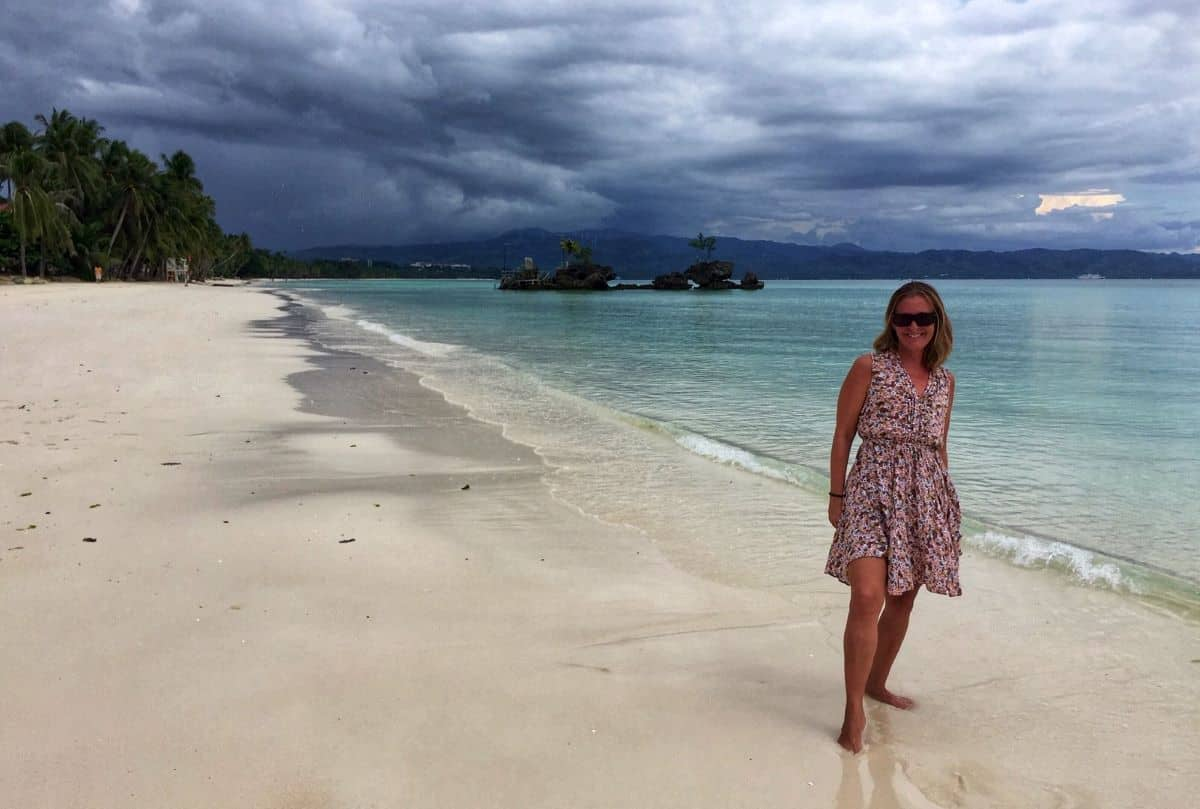Ellen on White Beach with gray clouds.