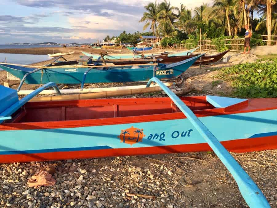 The Hang Out Express rests on the rock beach in the neighborhood of Motag, on mainland Malay in Aklan, Philippines.