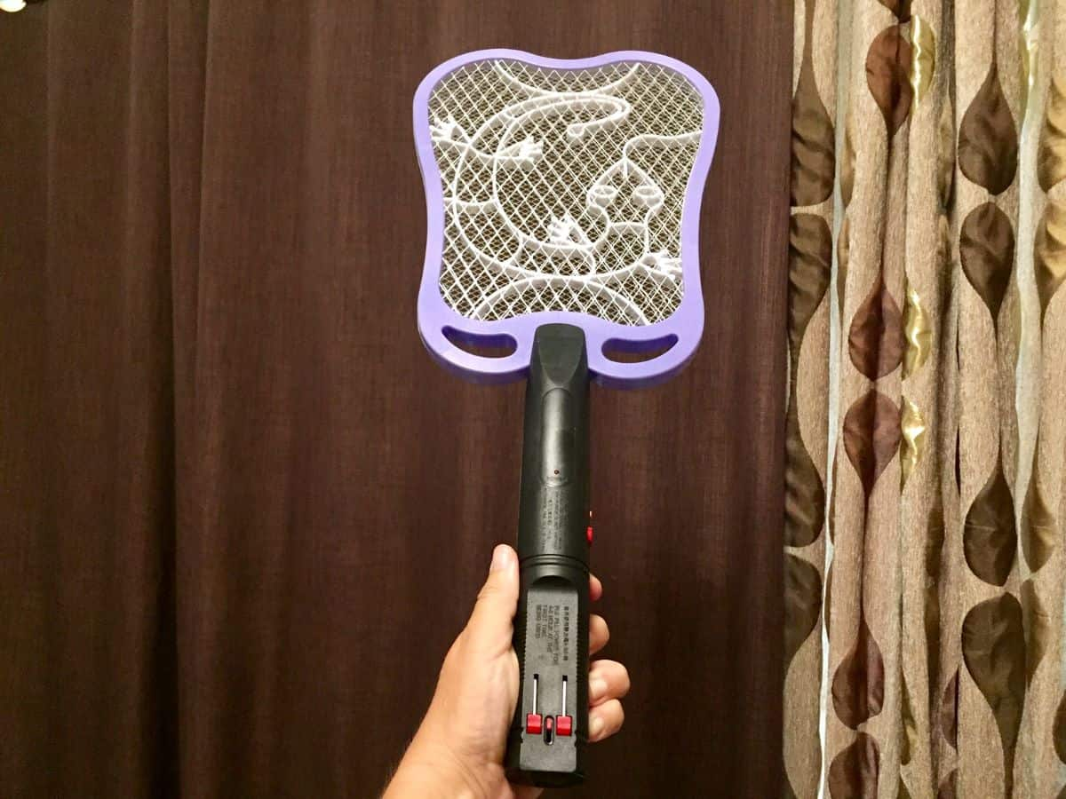 A mosquito zapper that is commonly found in tropical countries as a way to slay mosquitoes. It looks like a tennis racket.