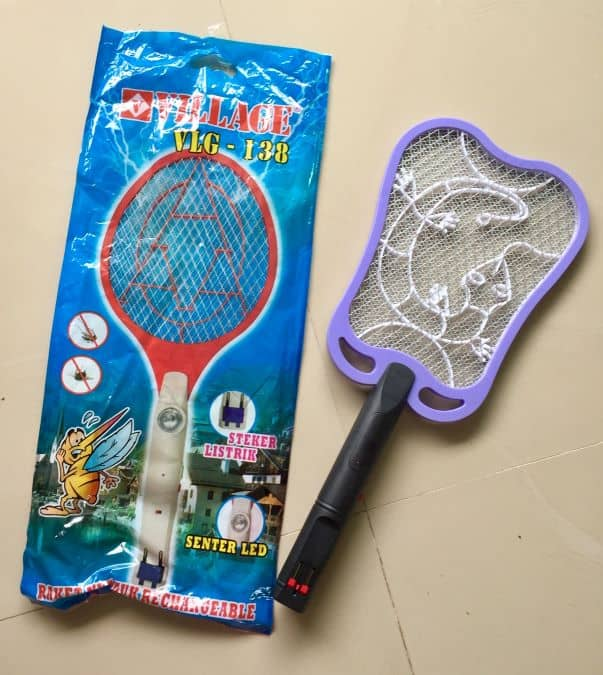 Mosquito zapper with packaging, it looks sort of like a tennis racket.